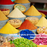 Buy-visit-trip-tour-Selection-of-spices-on-a-traditional-Moroccan-market-(souk)-in-Marrakech,-Morocco