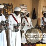 KHAMLIA,-MOROCCO—-Black-descendants-of-former-freed-slaves,-practicing-Gnawa-music,-in-a-small-village-near-the-desert
