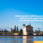Menara-gardens-reflecting-pool-and-pavilion-with-the-snow-capped-Atlas-mountains-in-the-background,-Marrakech,-Morocco.