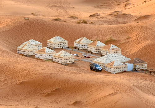 DESERT CAMP IN FULL SAND DUNES
