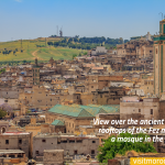 View-over-the-ancient-yellow-clay-rooftops-of-the-Fez-medina-with-a-mosque-in-the-background